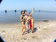 Two amateur bitches having fun with a lucky guy on a beach