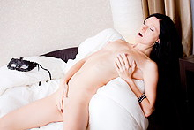 Hottie with a mask rubbing her cooch in artistic porn pics